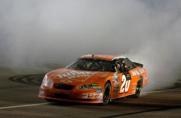 Tony Stewart (USA) celebrates winning the Nextel Cup. NASCAR Nextel Cup, Rd36, Homestead-Miami Speedway, Florida, USA, 20 November 2005. DIGITAL IMAGE