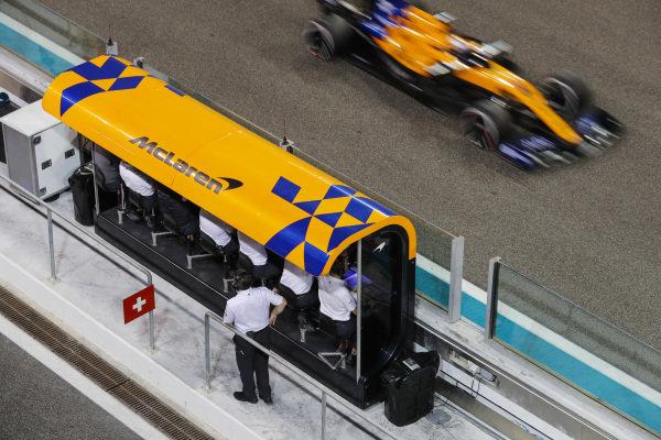 Carlos Sainz Jr., McLaren MCL34, passes the McLaren pit wall gantry
