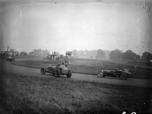 Dick Shuttleworth, Alfa Romeo Tipo B/P3, recovers from a spin as Charles Martin, Bugatti T59, approaches.