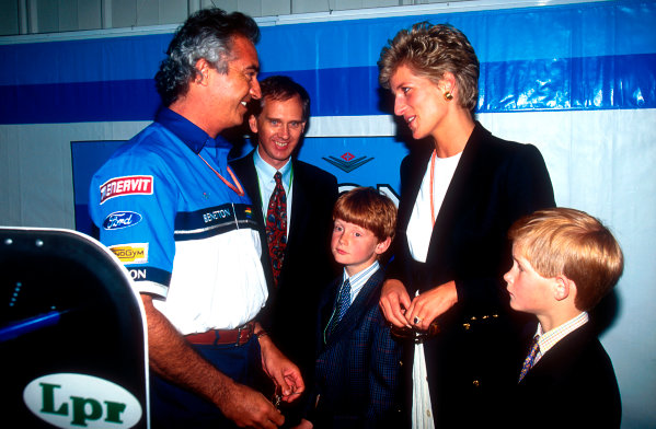 1994 British Grand Prix.Silverstone, England.8-10 July 1994.Benetton boss Flavio Briatore shows HRH the Princess of Wales and Prince Harry the team's garage. Ref-94 GB 07.World Copyright - LAT Photographic