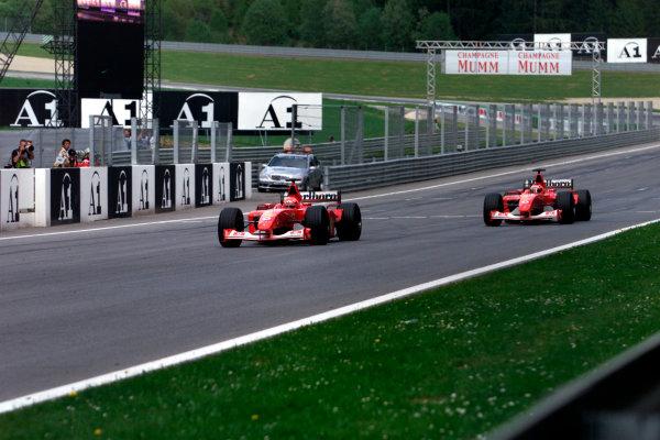 2002 Austrian Grand Prix.A1-Ring, Zeltweg, Austria.10-12 May 2002.Michael Schumacher, Ferrari F2002, follows team orders and takes over team mate Rubens Barrichello, Ferrari F2002.World Copyright: Photo4/LAT Photographicref: Digital Image Only