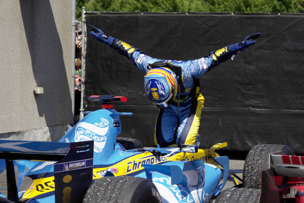 Fernando Alonso celebrates victory in parc fermé in his unique way.