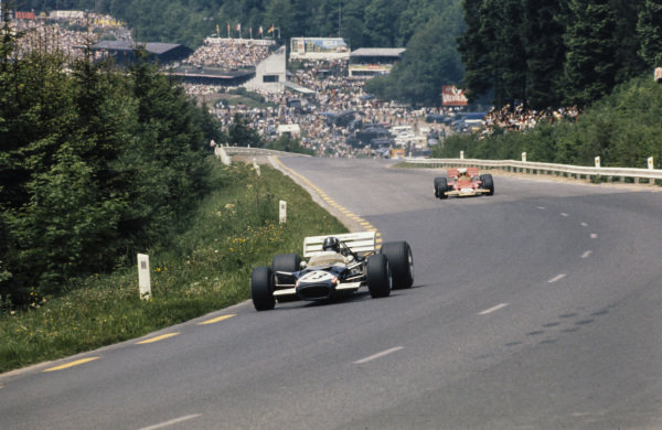 Graham Hill, Lotus 49C Ford leads John Miles, Lotus 72B Ford.