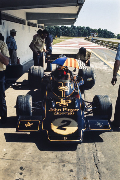 Emerson Fittipaldi, Lotus 72D Ford sits in the pits.