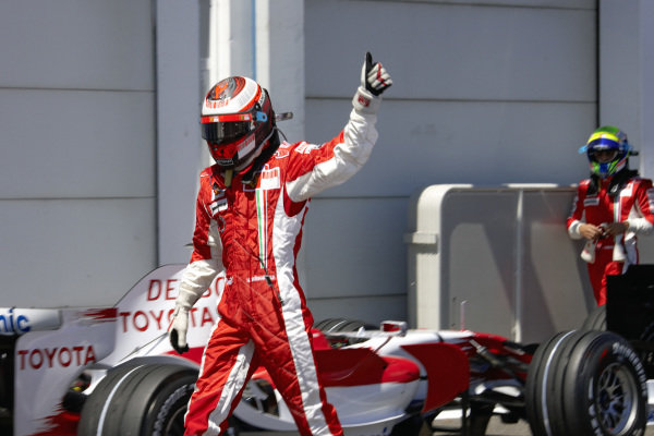 Pole sitter Kimi Räikkönen gives a thumbs up in parc ferme.