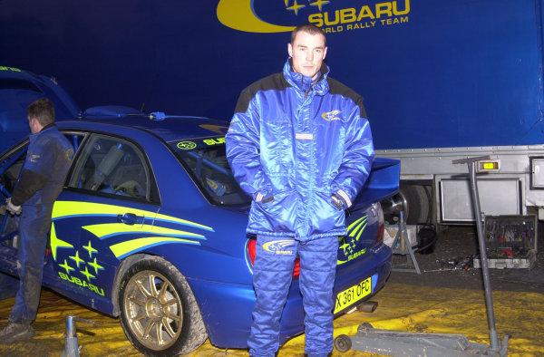 Col de Mens, France. December 18, 2000.Richard Burns stands next to the new Subaru Impreza 44S during testing for the new season.Photo: Ralph Hardwick