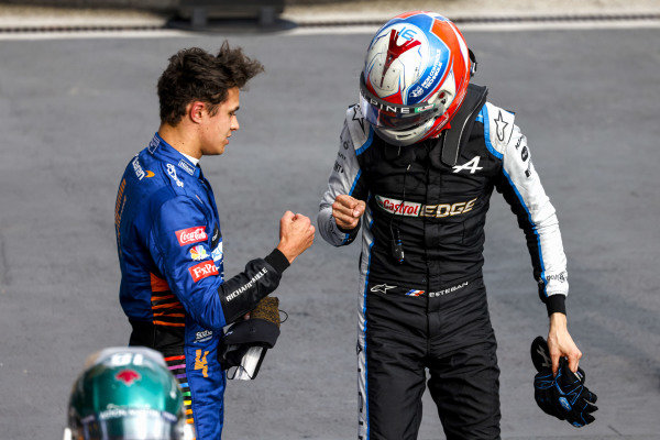 Esteban Ocon, Alpine F1, congratulates Lando Norris, McLaren, 3rd position, in Parc Ferme