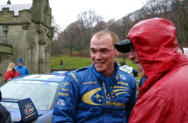2001 FIA World Rally Championship.Rally of Great Britain. Cardiff, Wales. November 22-25, 2001.Richard Burns is greeted by his excited father at the end of the last stage.Photo: Ralph Hardwick/LAT