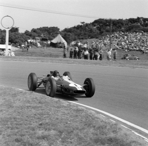 Jim Clark, Lotus 25 Climax, gets sideways.