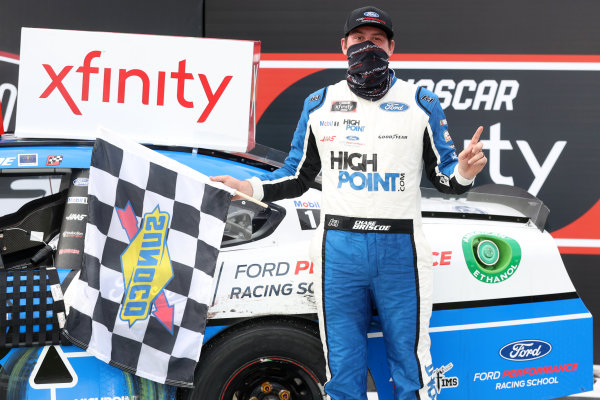 Chase Briscoe, Stewart-Haas Racing Ford, celebrates in Victory Lane, Copyright: Chris Graythen/Getty Images.