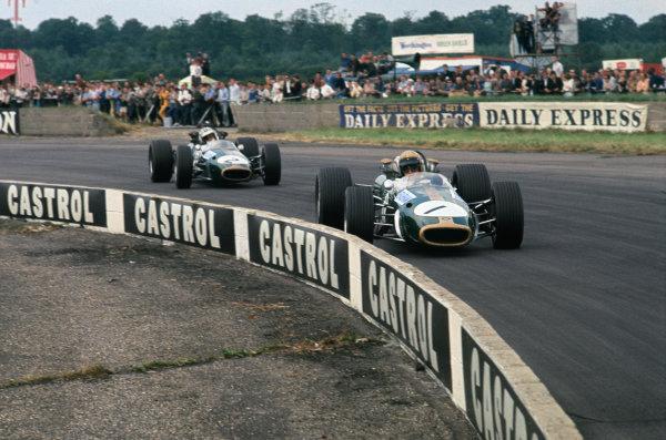 Silverstone, England 13th-15th July 1967. Jack Brabham leads Denny Hulme (both Brabham BT24-Repco), action.Ref: 67 GB 14 World Copyright: LAT Photographic