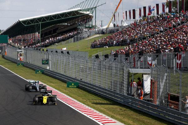 Daniel Ricciardo, Renault R.S.19, leads Valtteri Bottas, Mercedes AMG W10