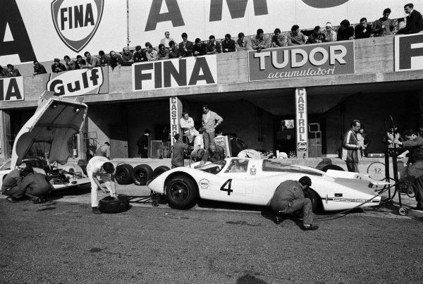 Mechanics checking on the Jo Siffert / Brian Redman, Porsche System Engineering, Porsche 908 LH 026 car before the start of the race.