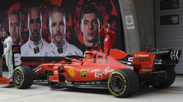 Sebastian Vettel, Ferrari, 3rd position, inspects his car in Parc Ferme