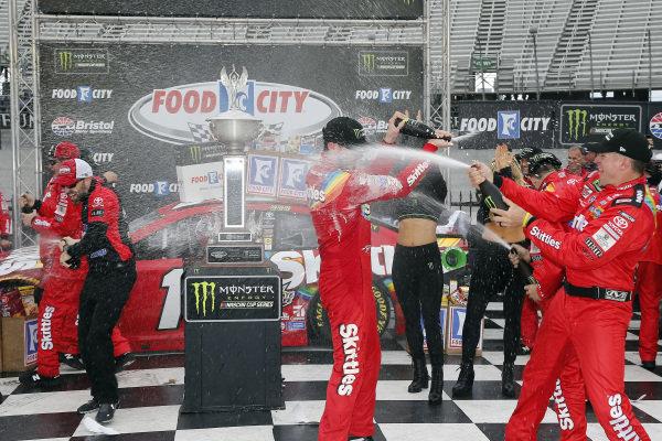 #18: Kyle Busch, Joe Gibbs Racing, Toyota Camry Skittles celebrates in victory lane