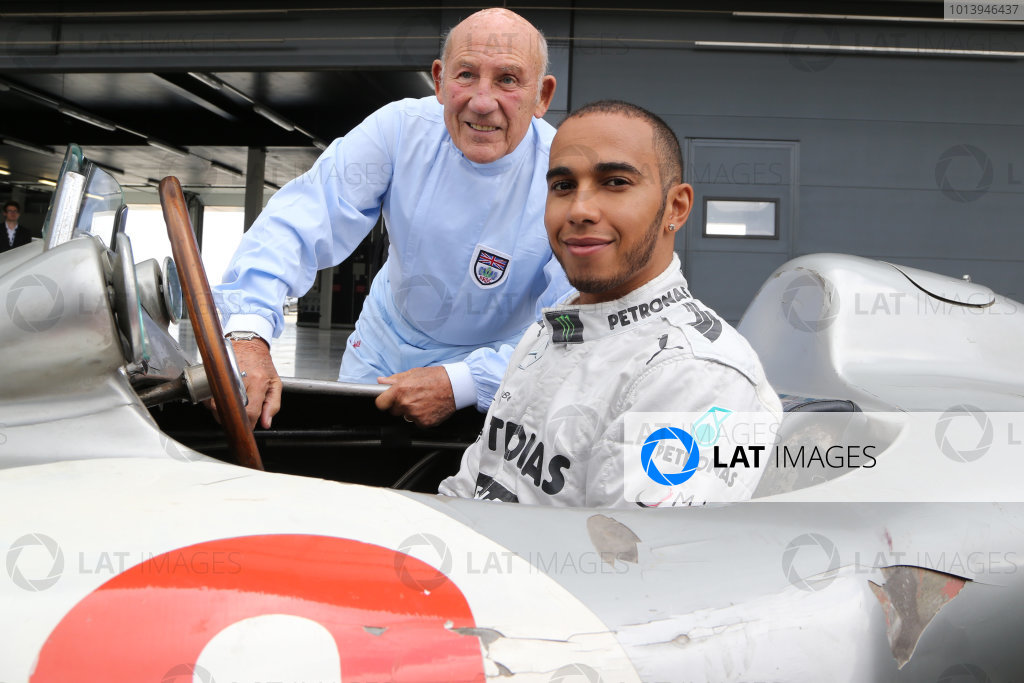 2013 British Grand Prix-  Preview Photo Call, Silverstone, Northants, 31st May 2013, Sir Stirling Moss (GBR) and Lewis Hamilton (GBR) in the Mercedes-  World Copyright: Jakob Ebrey/LAT Photographic