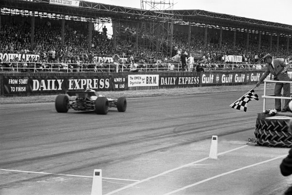Silverstone, Great Britain. 19 July 1969.Jackie Stewart, Matra MS80-Ford, 1st position, crosses the finish line and recieves the chequered flag, action.World Copyright: LAT Photographic