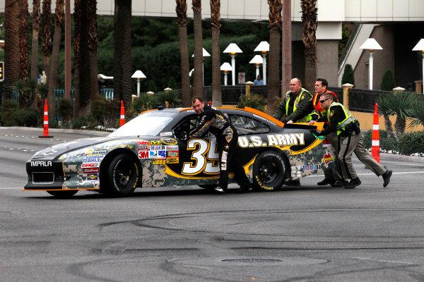30 November - 2 December, 2011, Las Vegas, Nevada, USARyan Newman pushes his car from the scene of the blown motor(c)2011, Michael L. LevittLAT Photo USA