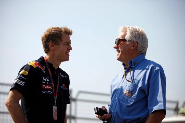 Korea International Circuit, Yeongam-Gun,South Korea.13st October 2011.Sebastian Vettel, Red Bull Racing RB7 Renault, talks with Charlie Whiting, Race Director, FIA. Portrait. World Copyright:Steven Tee/LAT Photographicref: Digital Image _I4V3275