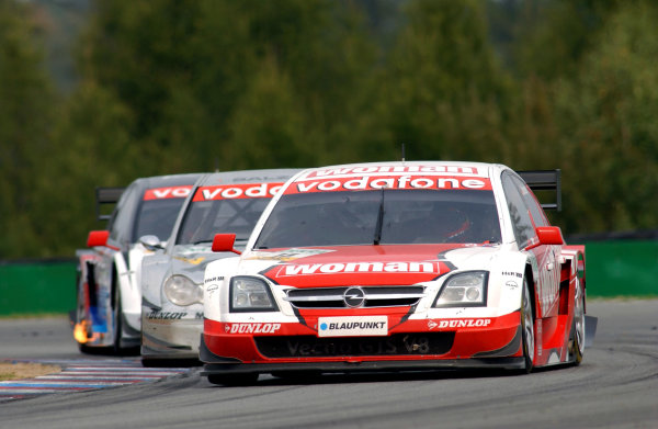 2004 DTM Championship Brno,Czech Republic. 18th - 19th September.Timo Scheider (OPC Holzer Opel Vectra GTS) leads Jean Alesi (HWA Mercedes C-Class) and Peter Dumbreck (OPC Phoenix Opel Vectra GTS). Action.World Copyright: Andre Irlmeier/LAT Photographic ref: Digital Image Only