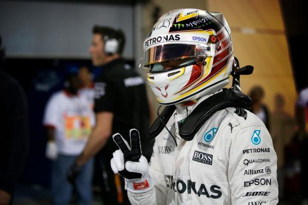 Bahrain International Circuit, Sakhir, Bahrain. Saturday 2 April 2016. Lewis Hamilton, Mercedes AMG celebrates after taking Pole Position. World Copyright: Glenn Dunbar/LAT Photographic ref: Digital Image _W2Q5619