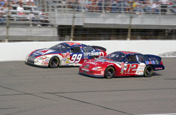 2000 NASCAR Winston Cup. North Carolina Speedway, Rockingham, NC, USA. 20th - 22nd October 2000. Rd 31. Jeremy Mayfield (Mobil 1 / World Series 2000 Ford), 29th position, passes Jeff Burton (Citgo Supergard Ford), 4th position, action.  World Copyright: Robt LeSieur / LAT Photographic.