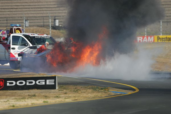 2004 American Le Mans Series (ALMS)Infineon Grand Prix of Sonoma, Sears Point. 16th - 18th July. Earnhardt Jr's car in flames following Sunday warmup accident.World Copyright: Richard Dole/LAT Photographicref: Digital Image Only