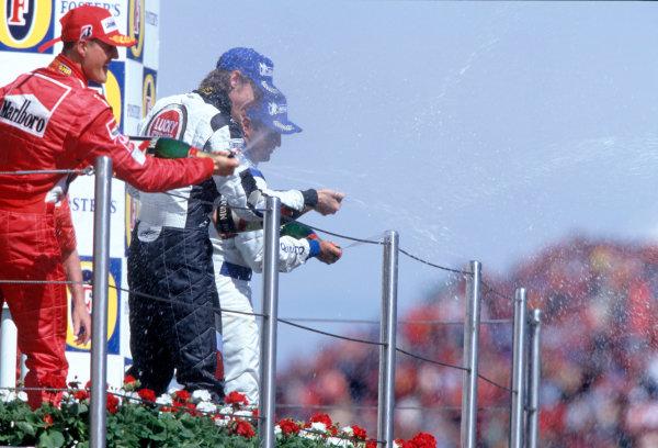 2004 San Marino Grand Prix, Imola, Italy. 23rd - 25th April.Michael Schumacher, Jenson Button and Juan Pablo Montoya spray the crowds.World Copyright: Steven Tee/LAT PhotographicRef: 35mm Transparency A14