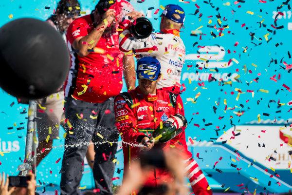 2016/2017 FIA Formula E Championship. Round 7 - Berlin ePrix, Tempelhof Airport, Berlin, Germany. Saturday 10 June 2017. Lucas Di Grassi (BRA), ABT Schaeffler Audi Sport, Spark-Abt Sportsline, ABT Schaeffler FE02, sprays the champagne on the podium. Photo: Zak Mauger/LAT/Formula E ref: Digital Image _54I7723