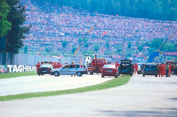 Imola, Italy.29/4-1/5 1994.Ayrton Senna's tradgic and untimely fatal accident. Here the race had been stopped and medical staff were treating him. The air ambulence then took him to hospital.Ref-94 SM 25.World Copyright - LAT Photographic