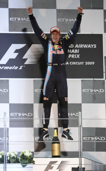 Yas Marina Circuit, Abu Dhabi, United Arab Emirates 1st November 2009. Sebastian Vettel, Red Bull Racing RB5 Renault, 1st position, celebrates on the podium. Portrait. Podium.  World Copyright: Steve Etherington/LAT Photographic ref: Digital Image SNE17926
