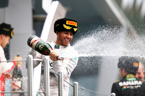Sochi Autodrom, Sochi, Russia. Sunday 11 October 2015. Lewis Hamilton, Mercedes AMG, 1st Position, sprays Champagne from the podium. World Copyright: Alastair Staley/LAT Photographic ref: Digital Image _R6T2497