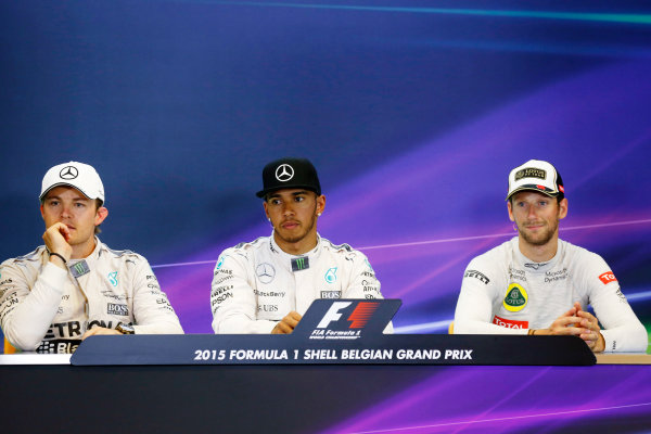 Spa-Francorchamps, Spa, Belgium. Sunday 23 August 2015. Lewis Hamilton, Mercedes AMG, 1st Position, Nico Rosberg, Mercedes AMG, 2nd Position, and Romain Grosjean, Lotus F1, 3rd Position, in the Press Conference. World Copyright: Alastair Staley/LAT Photographic ref: Digital Image _79P5676