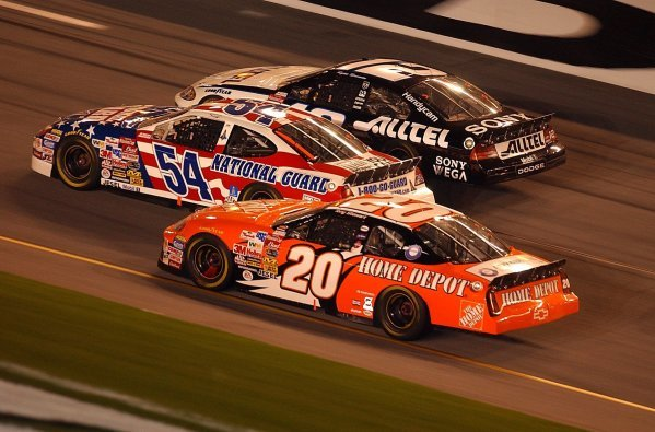 Three abreast as they approach the finish line (L to R): Fifteenth placed Tony Stewart (USA) Home Depot Pontiac; Todd Bodine (USA) Army National Guard Ford, who finished thirteenth; Ryan Newman (USA) ALLTEL Ford who finished fourth.Budweiser Shootout, Daytona International Speedway, Florida, USA, 8 February 2003.DIGITAL IMAGE