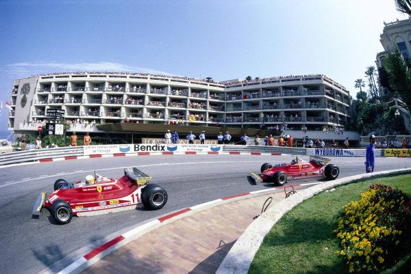 Jody Scheckter, Ferrari 312T4, leads his Ferrari teammate Gilles Villeneuve.