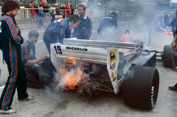 Brands Hatch, England. 20-22 July 1984. Engine fire for Ayrton Senna's Toleman TG184 Hart during qualifying. Ref: 84GB04. World Copyright - LAT Photographic
