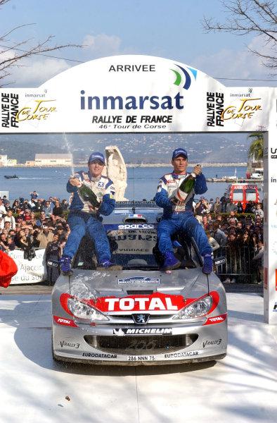 2002 World Rally ChampionshipInmarsat Corsica Rally, 8th-10th March 2002.The Panizzi brothers celebrate Peugeot's 1 - 2 - 3 on the podium.Photo: Ralph Hardwick/LAT