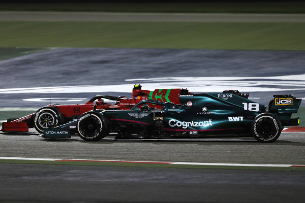 Carlos Sainz, Ferrari SF21, and Lance Stroll, Aston Martin AMR21, battle