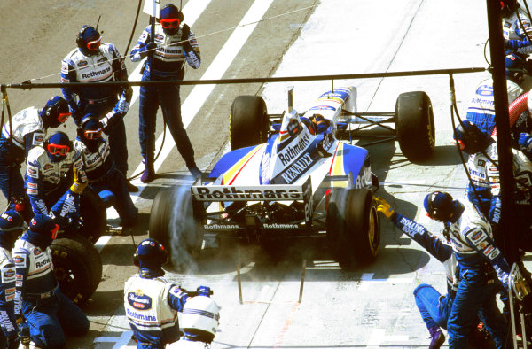 Hungaroring, Budapest, Hungary.9-11 August 1996.Jacques Villeneuve (Williams FW18 Renault) 1st position, burns rubber as he leaves his pit crew after a stop.Ref-96 HUN 05.World Copyright - LAT Photographic