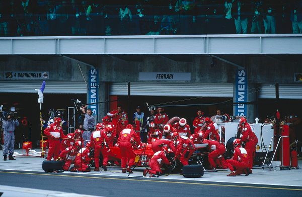 2000 United States Grand Prix.Indianapolis, Indiana, USA. 22-24 September 2000.Michael Schumacher (Ferrari F1-2000) takes a pitstop on his way to 1st position.Ref-2K USA 43.World Copyright - LAT Photographic