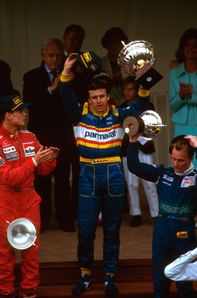 Monte Carlo, Monaco.16-19 May 1996.Olivier Panis (Ligier Mugen-Honda) 1st position, David Coulthard (McLaren Mercedes) 2nd position and Johnny Herbert (Sauber Ford) 3rd position on the podium.Ref-96 MON 02.World Copyright - LAT Photographic