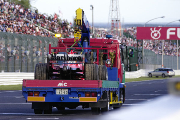 Michael Schumacher's Ferrari being returned to the pits after the race having suffered an engine failure; his first since 2000.