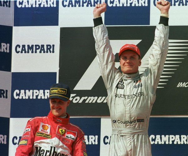 1998 San Marino Grand Prix. Imola, Italy. 24-26 April 1998. David Coulthard (McLaren Mercedes-Benz) and Michael Schumacher (Ferrari) after finishing in 1st and 2nd positions respectively. World Copyright - Steve Etherington/LAT Photographic
