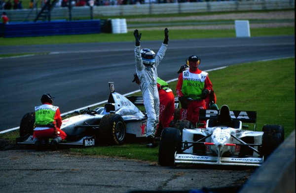 1997 British Grand Prix.Silverstone, England.11-13 July 1997.Mika Hakkinen (McLaren MP4/12 Mercedes-Benz) waves to the crowd after his car blew while leading.World Copyright - LAT Photographic
