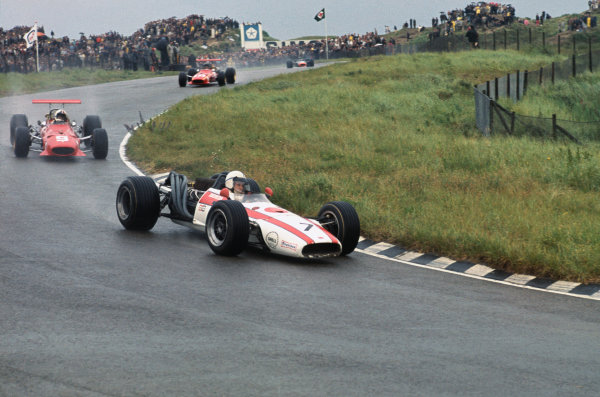 Zandvoort, Holland. 21-23 June 1968. John Surtees (Honda RA301) leads Chris Amon and Jacky Ickx (both Ferrari 312). Ickx and Amon finished in 4th and 6th positions respectively. Ref-68HOL16. World Copyright - LAT Photographic