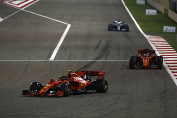 Charles Leclerc, Ferrari SF90, leads Sebastian Vettel, Ferrari SF90, and Lewis Hamilton, Mercedes AMG F1 W10