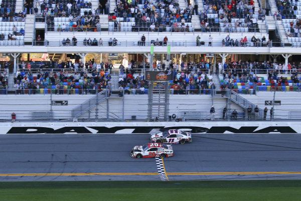 #20: Erik Jones, Joe Gibbs Racing, Toyota Camry Sports Clips and #11: Denny Hamlin, Joe Gibbs Racing, Toyota Camry FedEx Express take the checkered flag