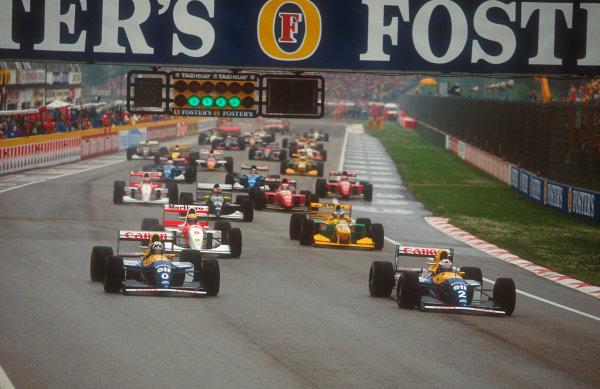 1993 San Marino Grand Prix.Imola, Italy. 23-25 April 1993.Alain Prost leads away with Damon Hill (both Williams FW15C Renault's), Ayrton Senna (McLaren MP4/8 Ford), Michael Schumacher (Benetton B193B Ford) and Karl Wendlinger (Sauber C12 Ilmor) at the start. Ref-93 SM 06.World Copyright - LAT Photographic