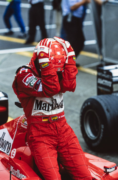 Michael Schumacher, 1st position, celebrates having secured his third F1 world title by winning the race.