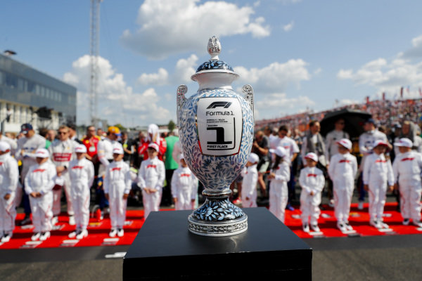 The trophy on the grid prior to the start